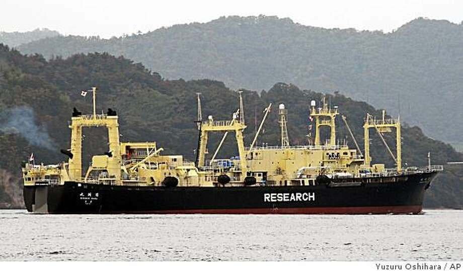In this photo released by the environmental group Greenpeace Japan, Japanese whaling ship Nisshin Maru departs from Innoshima, Hiroshima Prefecture (state), western Japan, Monday, Nov. 17, 2008. Nisshin Maru left its home port Monday en route to this season's whale hunt in the Antarctic Ocean, Greenpeace said. Japanese whalers plan to catch up to 935 minke whales and 50 fin whales. (AP Photo/Greenpeace Japan, Yuzuru Oshihara, HO) ** EDITORIAL USE ONLY CREDIT MANDATORY ** Photo: Yuzuru Oshihara, AP