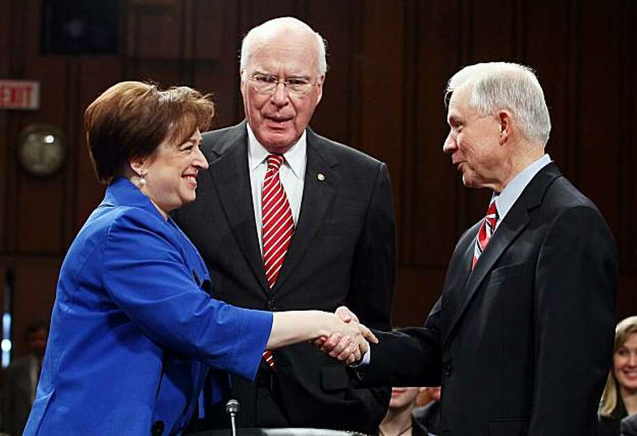 WASHINGTON - JUNE 28:  U.S. Supreme Court nominee Elena Kagan (L) shakes hands with Sen. Jeff Sessions (R-AL) (R), ranking member of the Senate Judiciary Committee, while Senate Judiciary Committee Chairman Sen. Patrick Leahy (D-VT) looks on, after she arrived for the first day of her confirmation hearings on Capitol Hill June 28, 2010 in Washington, DC.  Kagan is U.S. President Barack Obama's second Supreme Court nominee since taking office. Photo: Mark Wilson, Getty Images