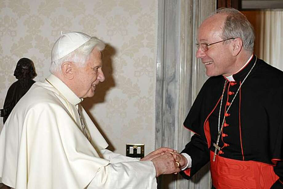 In this picture made available by the Vatican newspaper Osservatore Romano, Pope Benedict XVI, left, shakes hands with Vienna's archbishop, Cardinal Christoph Schoenborn during their private meeting at the Vatican, Monday, June 28, 2010. The Vatican on Monday admonished the leading cardinal for having publicly criticized the former Vatican No. 2 for his handling of clerical abuse cases. In a remarkable statement, the Vatican said only the pope can make such accusations against a cardinal, not another prince of the church. In April  Schoenborn accused the former Vatican secretary of state, Cardinal Angelo Sodano, of blocking a probe into a sex abuse scandal that rocked the Austria's church 15 years ago. Photo: Osservatore Romano, Associated Press