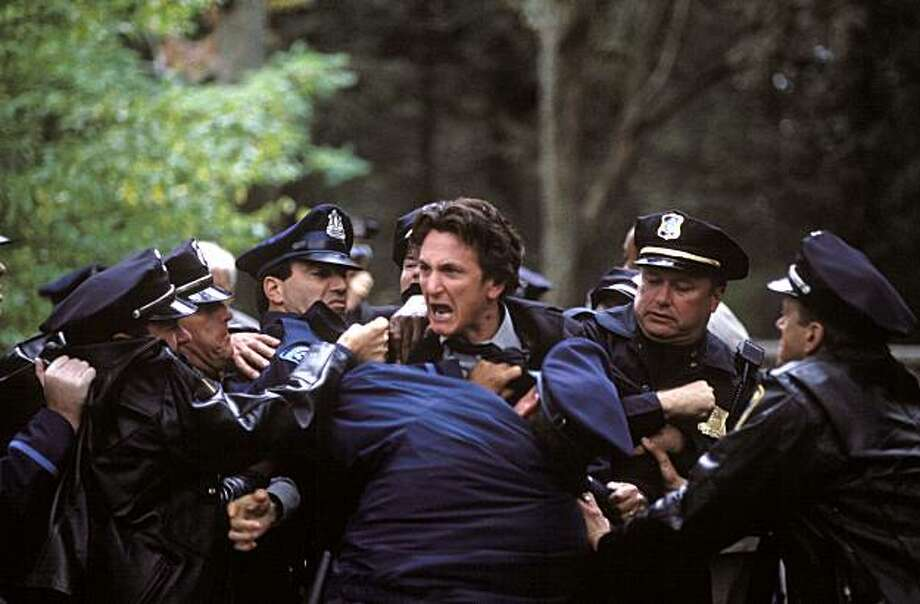 "Police try to subdue Sean Penn, center, in a scene from ""Mystic River,"" in this undated publicity photo. Photo: Merie W. Wallace, AP"