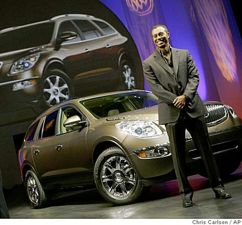 In this Nov. 28, 2006 file photo, Tiger Woods helps to introduce the 2008 Buick Enclave to the media at the Los Angeles Auto Show in Pasadena. Photo: Chris Carlson, AP