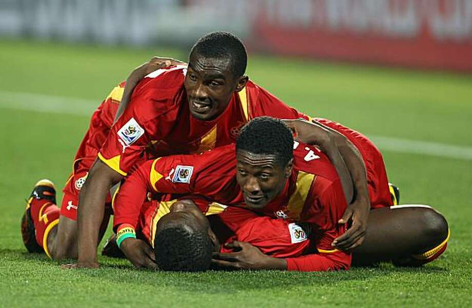 RUSTENBURG, SOUTH AFRICA - JUNE 26:  Asamoah Gyan (R) of Ghana celebrates victory with Sulley Muntari and Lee Addy (L) of Ghana during the 2010 FIFA World Cup South Africa Round of Sixteen match between USA and Ghana at Royal Bafokeng Stadium on June 26,2010 in Rustenburg, South Africa. Photo: Phil Cole, Getty Images