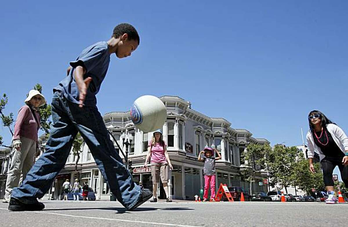 A four-square game in the middle of Broadway in downtown Oakland attracted players of all ages on Sunday.