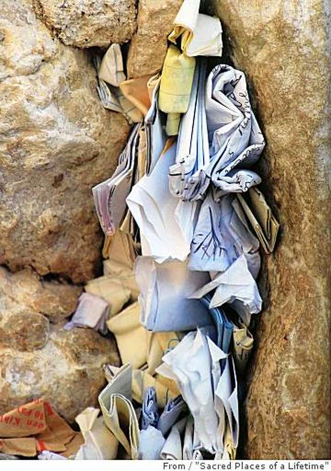 "Crevices in the Western Wall overflow with messages, Jerusalem. / From ""Sacred Places of a Lifetime"" Photo: From, ""Sacred Places Of A Lifetime"""