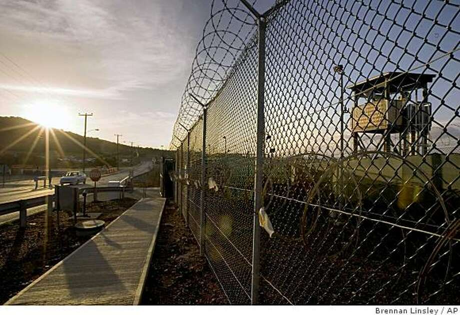 ** FILE ** In this June 6, 2008 file photo, reviewed by the U.S. Military, the sun rises over Camp Delta detention compound at Guantanamo Bay U.S. Naval Base, in Cuba.  (AP Photo/Brennan Linsleyl, File) Photo: Brennan Linsley, AP