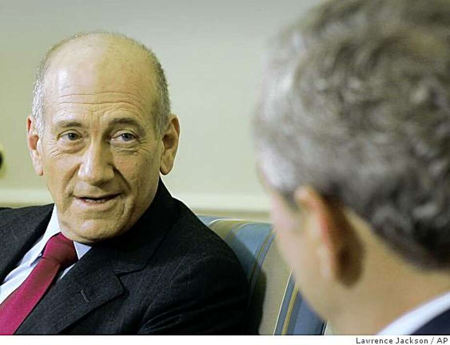 Prime Minister Ehud Olmert of Israel talks with U.S. President George W. Bush in the Oval Office of the White House in Washington, Monday, Nov. 24, 2008. (AP Photo/Lawrence Jackson) Photo: Lawrence Jackson, AP