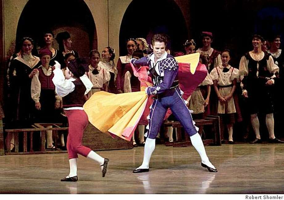 Maykel Solas (as Alonzo) demonstrates his technique to an admiring crowd in Act I of Flemming Flindt's THE TOREADOR at Ballet San Jose. Photo: Robert Shomler