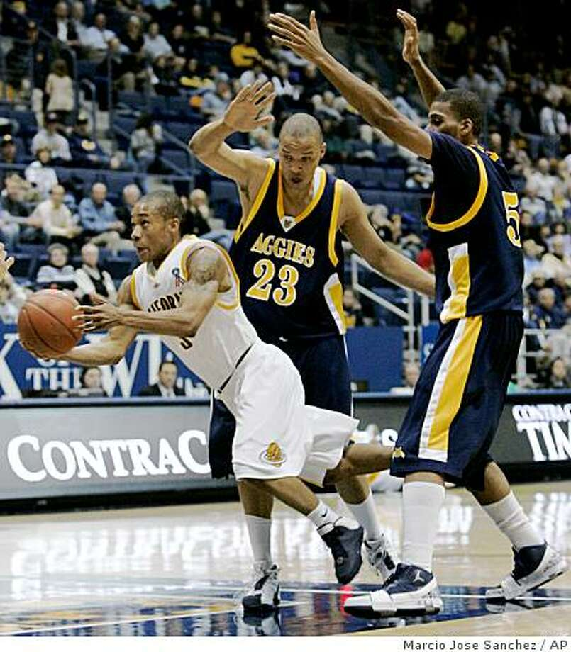 California's Jerome Randle, left, drives past North Carolina A&T's Thomas Coleman, center, and Julian McClurkin in the first half of an NCAA college basketball game in Berkeley, Calif., Monday, Nov. 24, 2008. (AP Photo/Marcio Jose Sanchez) Photo: Marcio Jose Sanchez, AP