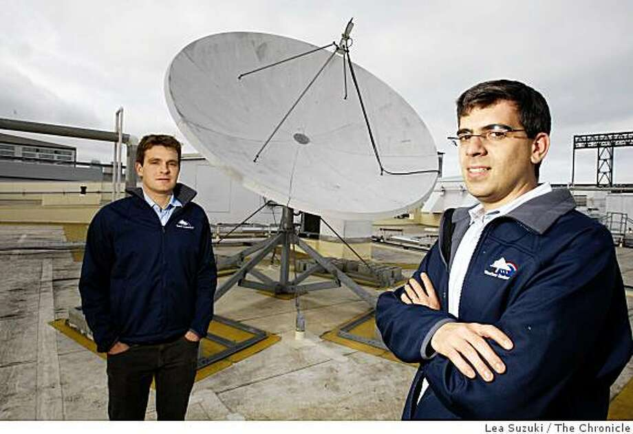 Toby Skinner (l to r) Weather Underground Director of Marketing and Alan Steremberg, Weather Underground President photographed with the satellite dish on top of Weather Underground's office building in San Francisco, Calif. on Wednesday, November 19, 2008. Photo: Lea Suzuki, The Chronicle