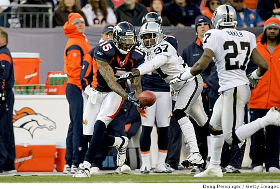 DENVER - NOVEMBER 23:  Wide receiver Brandon Marshall #15 of the Denver Broncos is unable to make a reception as Chris Johnson #37 of the Oakland Raiders defends during week 12 NFL action at Invesco Field at Mile High on November 23, 2008 in Denver, Colorado. The Raiders defeated the Broncos 31-10.  (Photo by Doug Pensinger/Getty Images) Photo: Doug Pensinger, Getty Images