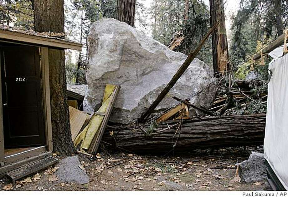 A boulder is shown after a rock slide at Curry Village in Yosemite National Park, Calif., Monday, Oct. 20, 2008. Falling rocks at one of America's most popular parks, Yosemite, have led to lawsuits and scientific debate over whether construction in the park has increased the danger and contributed to the deaths. Since 1999, 20 of the structures at Curry Village have been directly hit by boulders and many more damaged by flying rocks. (AP Photo/Paul Sakuma) Photo: Paul Sakuma, AP