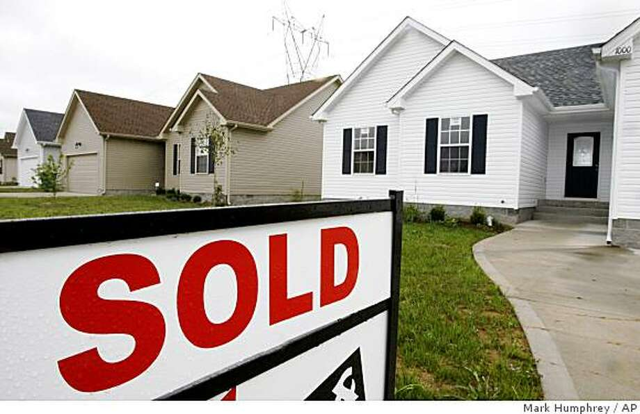 A sold sign is displayed in the yard of a house in Clarksville, Tenn., near the Fort Campbell military base, Oct. 16, 2008. While overall national home prices and sales are down, there are pockets in the U.S. doing well that include military base communities. (AP Photo/Mark Humphrey) Photo: Mark Humphrey, AP