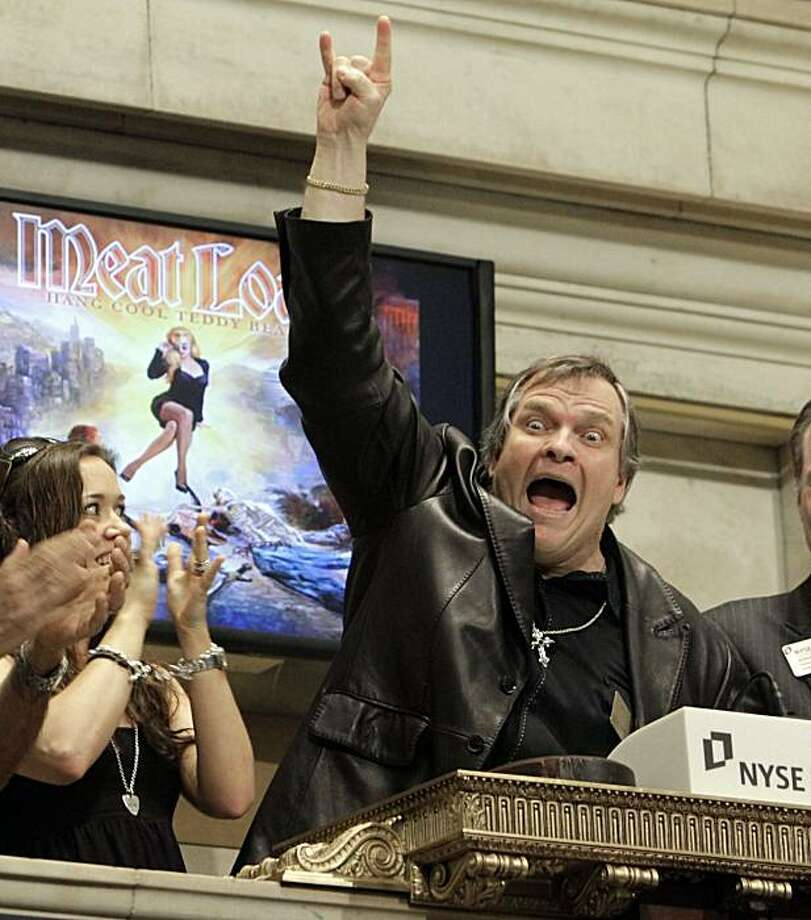 Rock singer Meatloaf rings the opening bell of the New York Stock Exchange, Monday, June 21, 2010, in New York. Photo: Richard Drew, AP