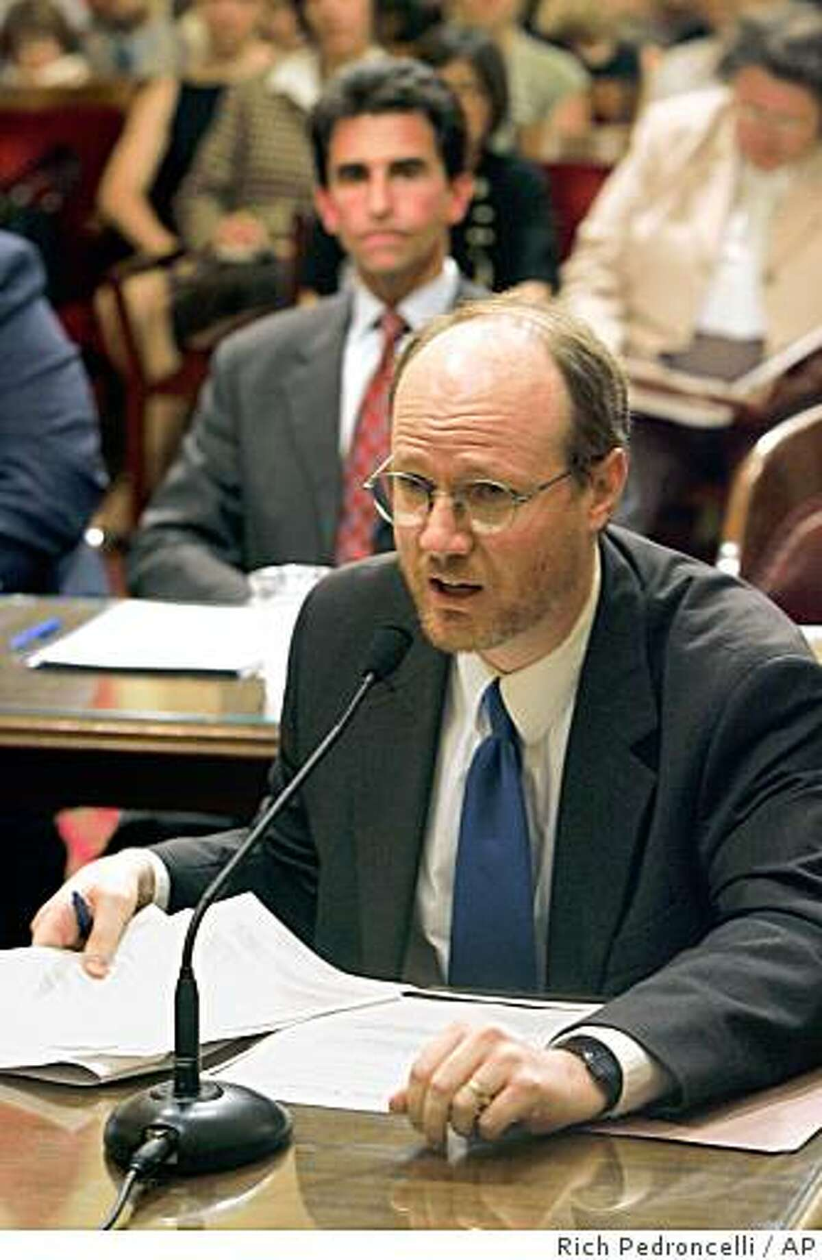 Gay marriage opponent Randy Thomasson urged lawmakers to reject a same-sex marriage bill before the Senate Judiciary committee during a hearing held at the Capitol in Sacramento, Calif., Tuesday, July 12, 2005. The measure, by Assemblyman Mark Leno, D-San Francisco, background, is similar to a same-sex marriage bill that was defeated in the Assembly in June. Despite the opposition it was approved 4-1 by the committee. (AP Photo/Rich Pedroncelli) Ran on: 07-13-2005 Randy Thomasson urges lawmakers to reject the same-sex marriage bill written by Assemblyman Mark Leno (background).