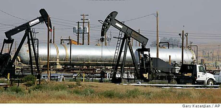 **FILE** In this June 26, 2008 file photo, oil well pump jacks of Chevron Corp. are shown in the hills in Coalinga, Calif. Flush with cash from huge profits, Big Oil could be preparing to get bigger. (AP Photo/Gary Kazanjian, File) Photo: Gary Kazanjian, AP