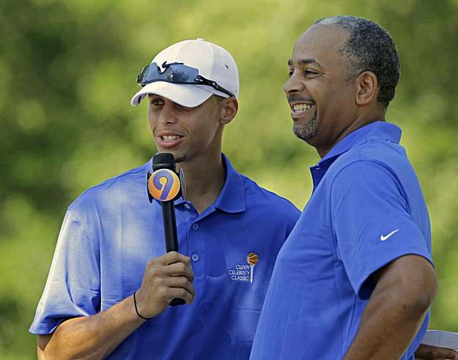 Golden State's Stephen Curry, left, interviews his father, former Charlotte Hornets player Dell Curry, before the Curry Celebrity Classic in Davidson, N.C., Monday, June 21, 2010.  After an impressive rookie season with Golden State, Curry is back home for the summer. Photo: Chuck Burton, AP