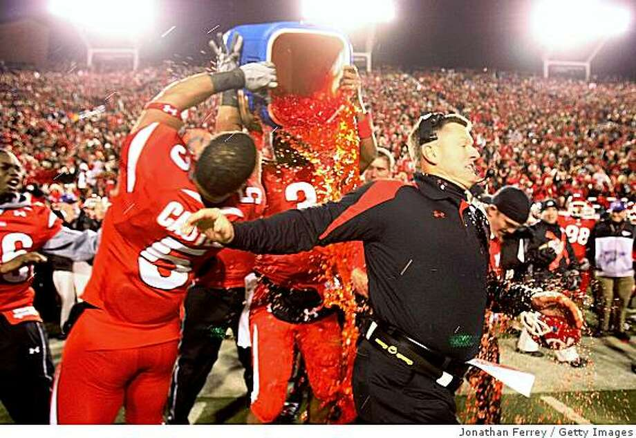 SALT LAKE CITY - NOVEMBER 22:  Head Caoch Kyle Whittingham of the Utah Utes is doused by Gatorade by Brent Casteel #5 and Brian Johnson #3  after defeating the BYU Cougars 48-24 to complete a pefect 12-0 season at Rice-Eccles Stadium on November 22, 2008 in Salt Lake City, Utah.  (Photo by Jonathan Ferrey/Getty Images) Photo: Jonathan Ferrey, Getty Images