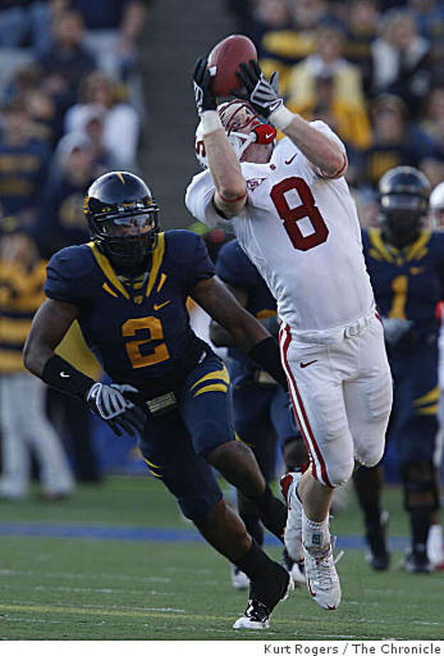 Stanford's Ryan Whalen pulls down a pass in the third Quarter over Cal's Bernard Hicks  as  California  defeats Stanford, 37-16 in the annual Big Game in Berkeley, Calif, on Saturday, Nov. 22, 2008. Photo: Kurt Rogers, The Chronicle