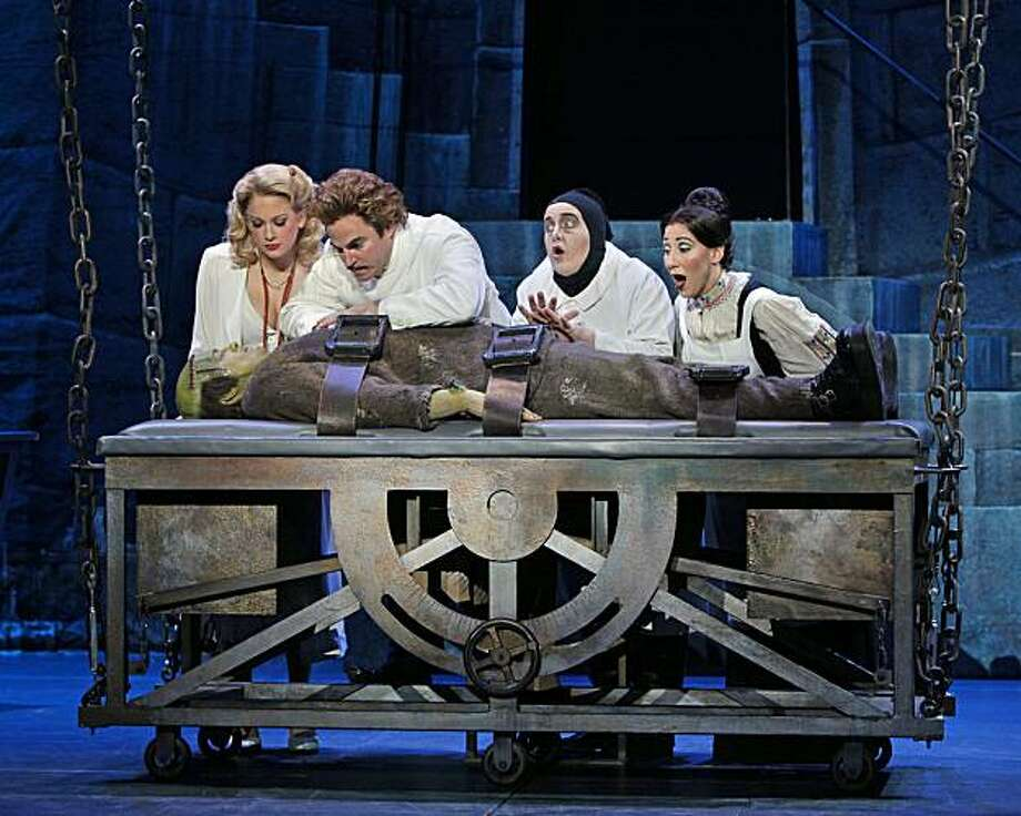 "Anne Horak, Roger Bart, Cory Engligh and ???? behind table.  Shuler Hensley on the table. in the National Tour of ""Young Frankenstein."" Photo: Paul Kolnik"