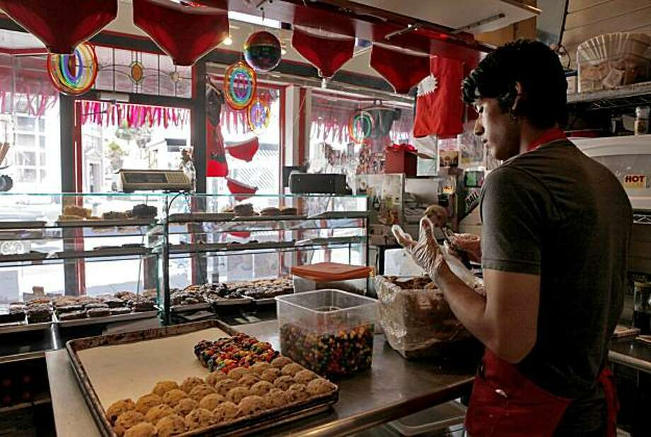 Josh Moreno, 21 has worked at the Hot Cookie Shop for five years, makes cookies to freeze in preparation of this weekend, Wednesday June 23, 2010, in San Francisco, Calif. Moreno,  loved the community and doesn't want to go anywhere else, because of what he might find. Photo: Lacy Atkins, The Chronicle
