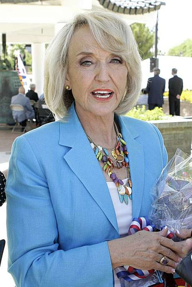 Arizona Gov. Jan Brewer attends a ceremony commemorating the 60th Anniversary of the start of the Korean War, Friday, June 25, 2010, in Phoenix.  Brewer  stands by her statements regarding illegal immigration from an early debate, saying most illegal immigrants entering Arizona are being used to transport drugs across the border. Photo: Ross D. Franklin, AP