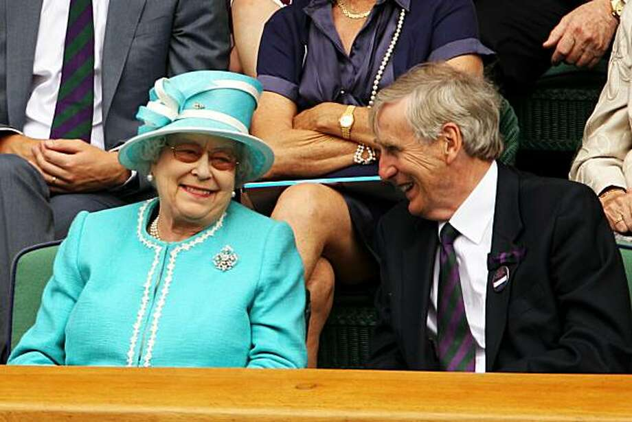 LONDON, ENGLAND - JUNE 24:  Queen Elizabeth II watches Andy Murray at the Wimbledon Lawn Tennis Championships, escorted by Wimbledon Chairman Tim Phillips CBE on Day 4 at the All England Lawn Tennis and Croquet Club on June 24, 2010 in London, England. Itis the first visit by Queen Elizabeth II to the Championships in 33 years. Photo: Oli Scarff, Getty Images