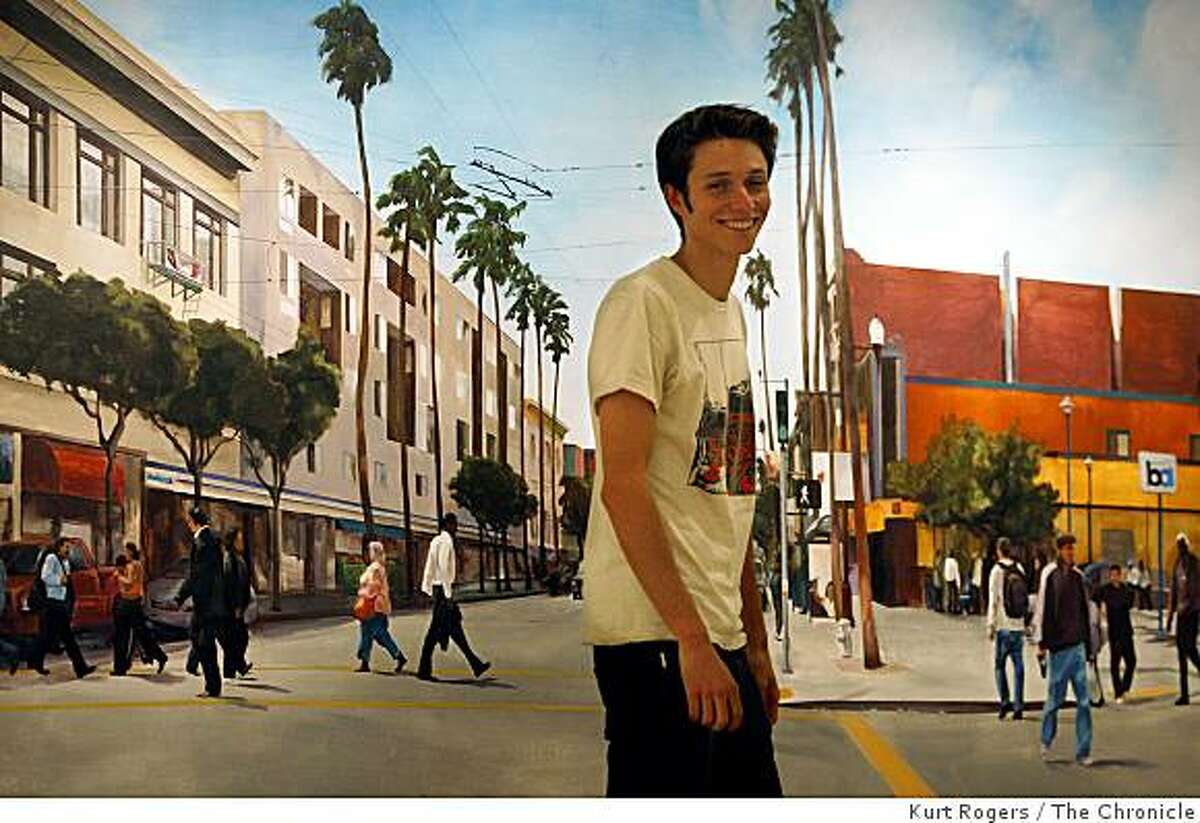 Evan Bissel in front of a mural that he did on the wall of the Intersection for the Arts where his current exhibit of faces from the mission is on display on Tuesday Nov 18 2008 in San Francisco, Calif