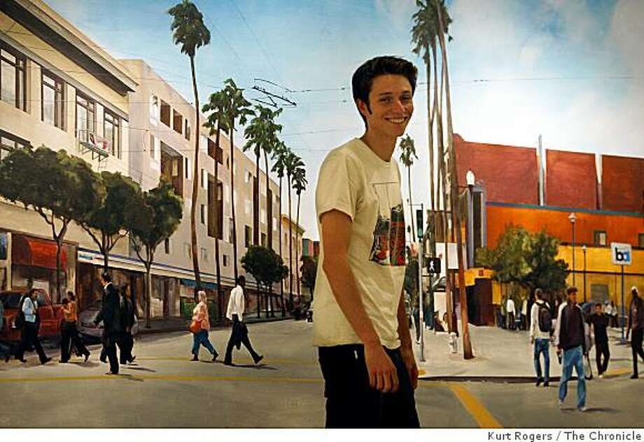 Evan Bissel in front of a mural that he did on the wall of the Intersection for the Arts where his current exhibit of faces from the mission is on display on Tuesday Nov 18  2008 in San Francisco, Calif Photo: Kurt Rogers, The Chronicle