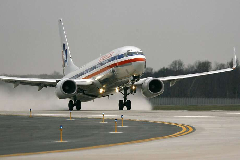 An American Airlines plane is the first to take off from the new fourth runway at Dulles International Airport in Chantilly, Va. on Thursday, Nov. 20, 2008. (AP Photo/Jacquelyn Martin) **Also to be used for the story, Dulles Expansion** Photo: Jacquelyn Martin, AP