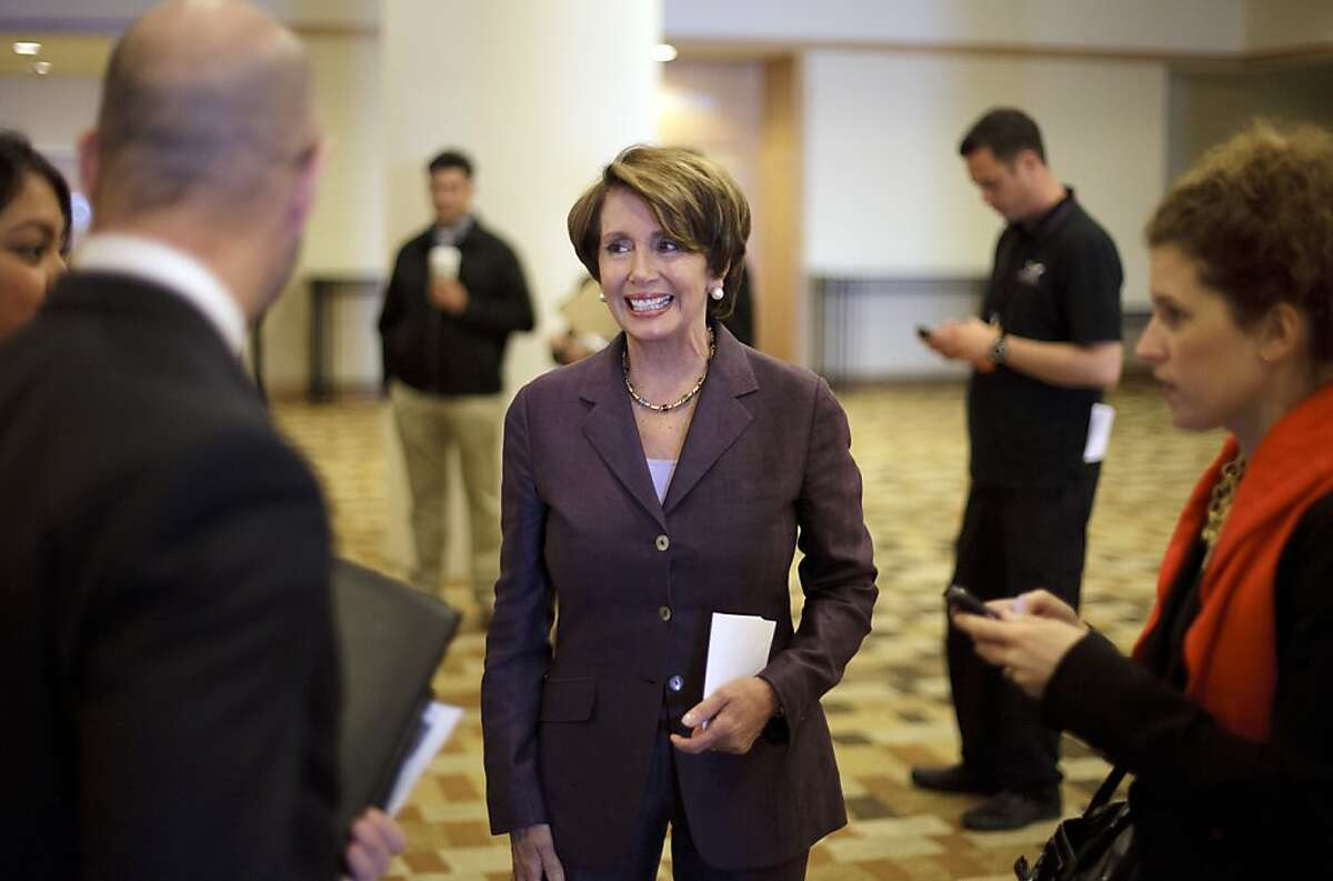 House Minority Leader Nancy Pelosi of Calif., speaks with reporters and aides after a news conference on the first day of the California Democrats State Convention Friday, Feb. 10, 2012, in San Diego. The annual convention continues through Feb. 12.