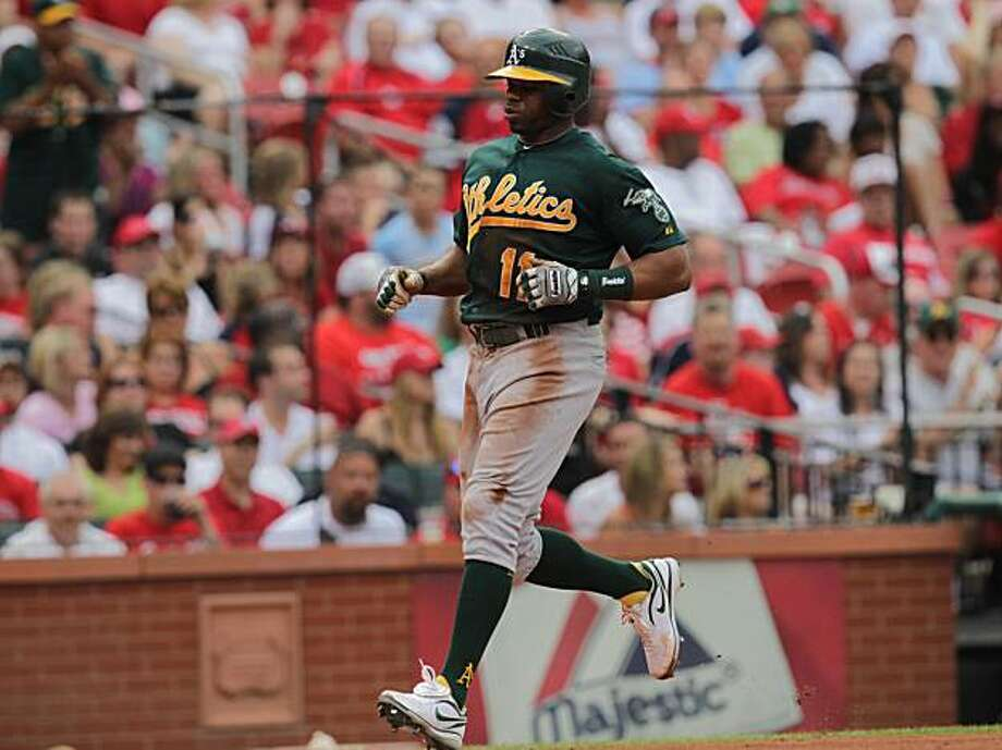 The Oakland Athletics' Rajai Davis scores in the first inning on wild throw by St. Louis Cardinals catcher Yadier Molina in attempt to stop a double steal at Busch Stadium in St. Louis, Missouri, Saturday, June 19, 2010. (Laurie Skrivan/St. Louis Post-Dispatch/MCT) Photo: Laurie Skrivan, MCT