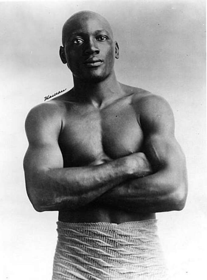 Heavyweight Champion Jack Johnson was convicted in 1913 of violating the Mann Act, which made it illegal to transport women across state lines for immoral purposes, for his involvement with a white woman. Photo: Infotainmentnews.com