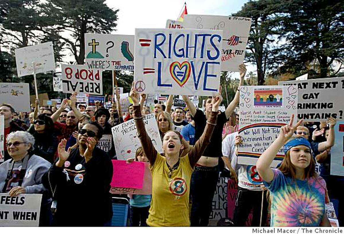 Jessica Hales of Los Angeles, center, joins thousands taking part in a statewide protest against the passage of proposition 8 in early November,as thousands gathered on the steps of the California State Capitol building in Sacramento, Calif. on Saturday Nov. 22, 2008.
