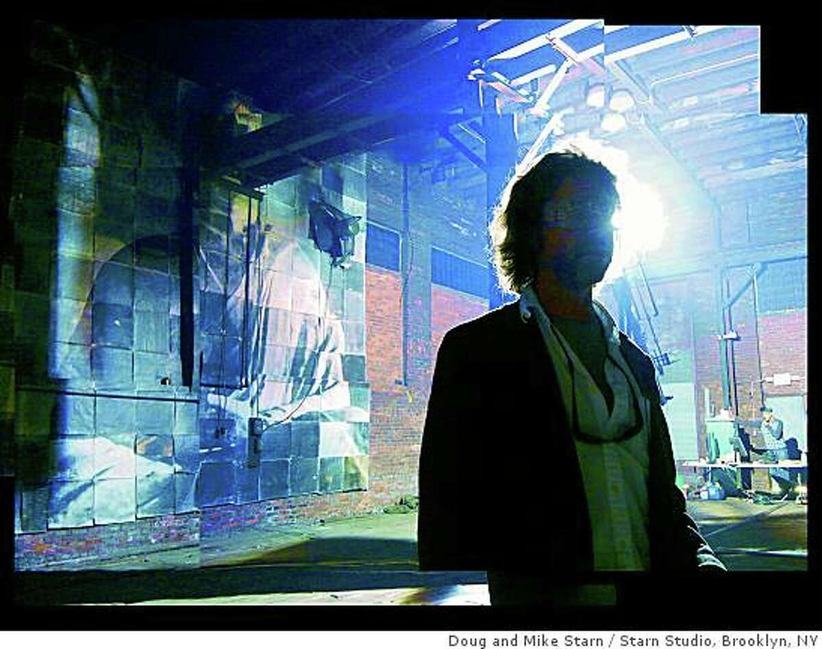 Mike Starn stands in the photography and light installation