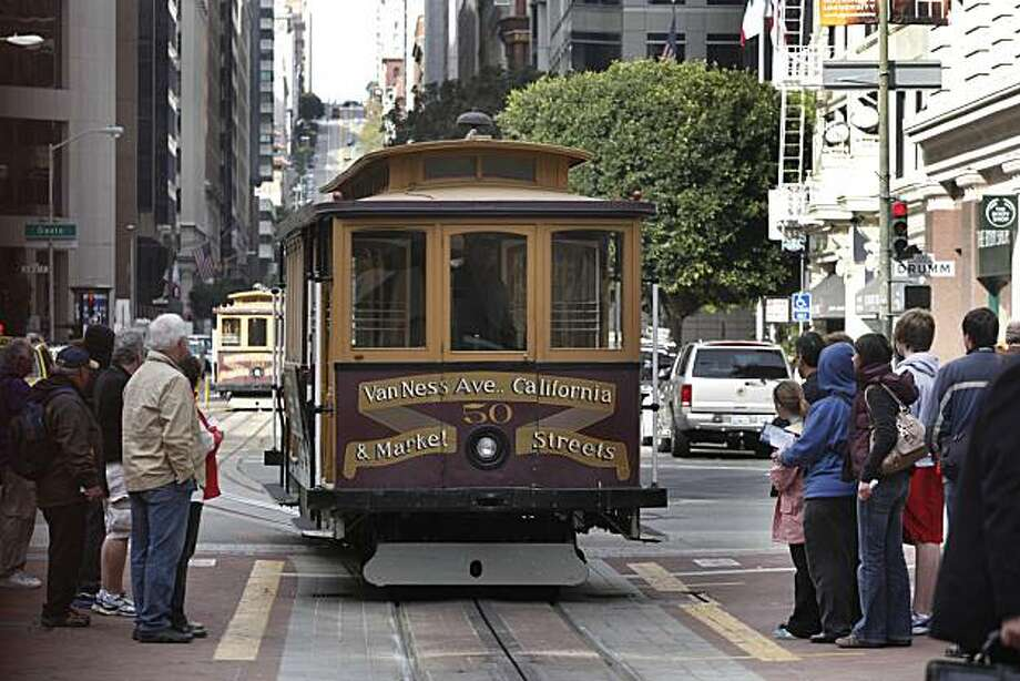People prepare to board the San Francisco cable car California line on California at Drumm Streets in San Francisco, Calif. on Wednesday, March 24, 2010. The California line will be closed beginning January 1 to July 1 for repairs and rebuilding funded through Measure K, the San Francisco transportation sales tax. Photo: Lea Suzuki, The Chronicle