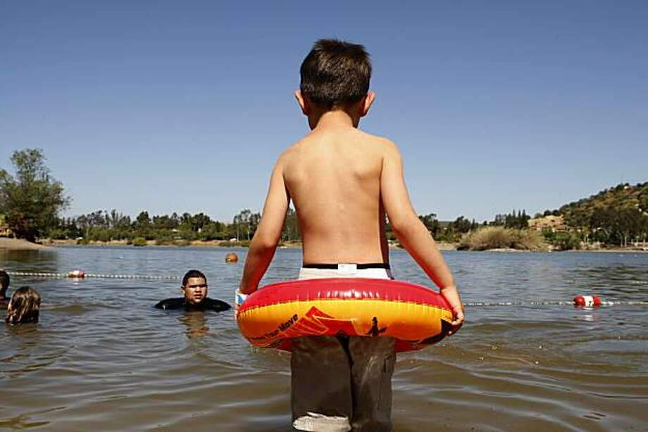 Five-year-old Lee Carrillo wades cautiously in the water along the west shore of Almaden Lake on his families first visit to the park on Thursday, June 17, 2010 in San Jose, Calif. Photo: John Sebastian Russo, The Chronicle