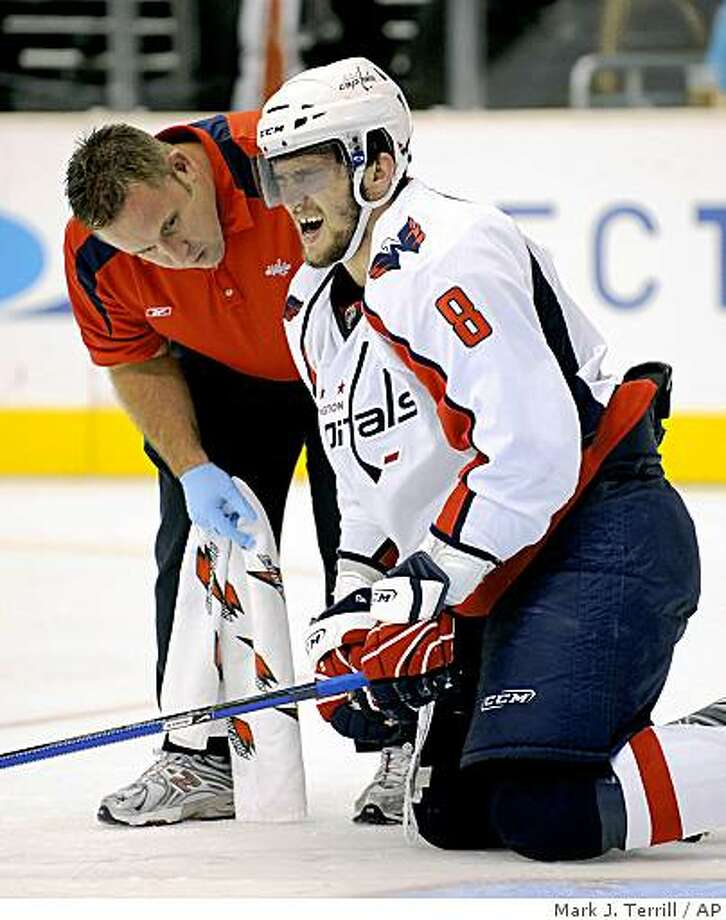 Washington Capitals left wing Alex Ovechkin reacts after being injured as a trainer sees to him during the third period, Thursday, Nov. 20, 2008, in Los Angeles. The Kings won 5-2. Photo: Mark J. Terrill, AP