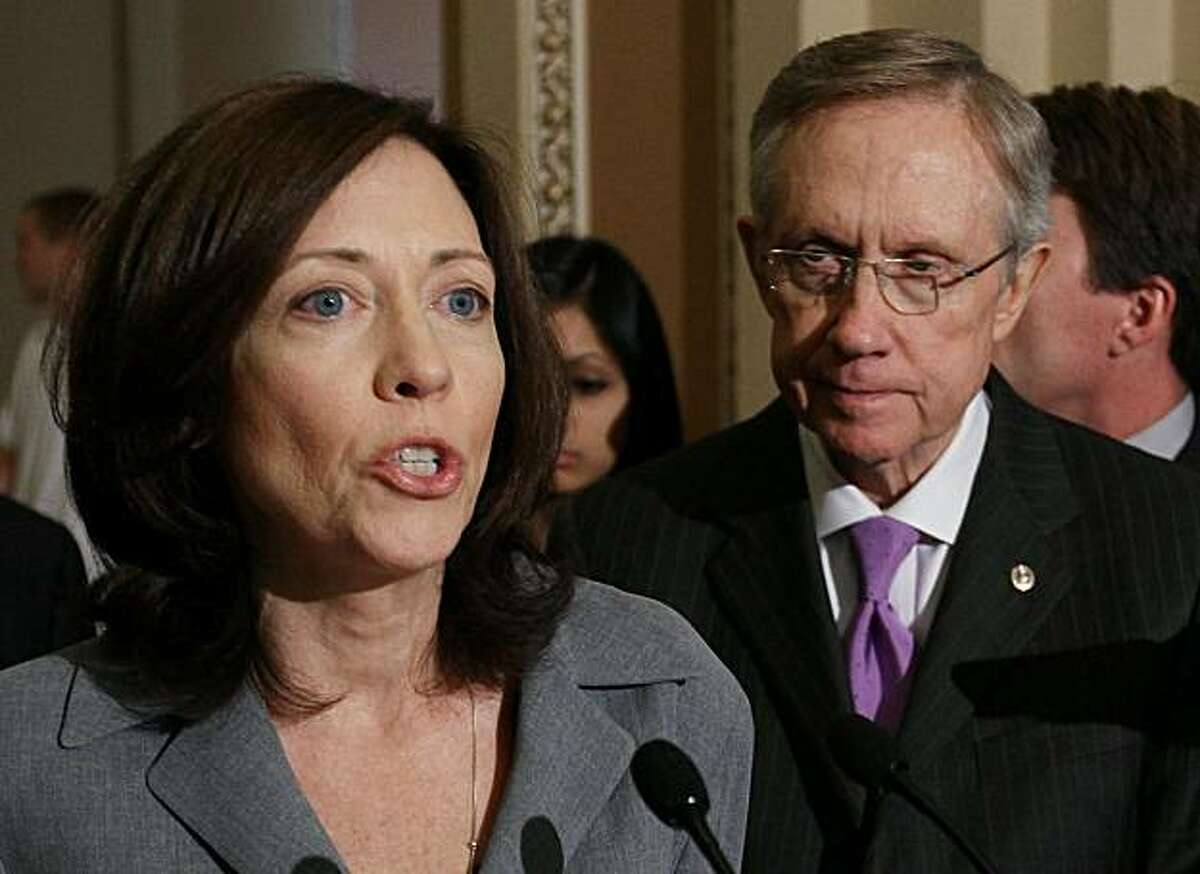 WASHINGTON - JUNE 17: U.S. Sen. Maria Cantwell (D-WA) (L), speaks while flanked by Senate Majority Leader Harry Reid (D-NV) during a news conference on clean energy, June 17, 2010 in Washington, DC. The Senate energy leaders met for a special causcus todiscuss Americas clean energy options.