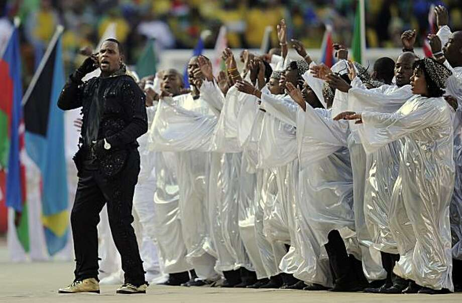 U.S. performer R. Kelly, left, sings during the opening ceremony, before the World Cup group A soccer match between South Africa and Mexico at Soccer City in Johannesburg, South Africa, Friday, June 11, 2010. Photo: Martin Meissner, AP