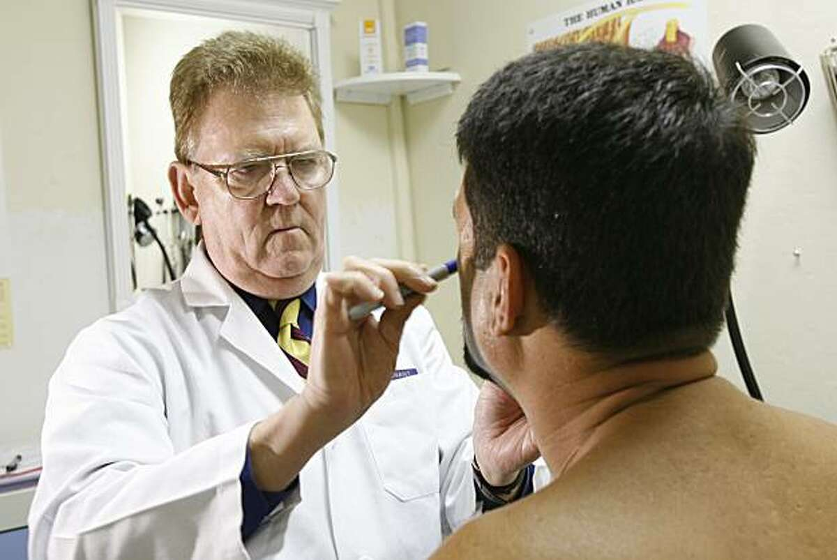 Dr. Marcus Conant performs a plastic surgery procedure at his office in San Francisco, May 4, 2006.