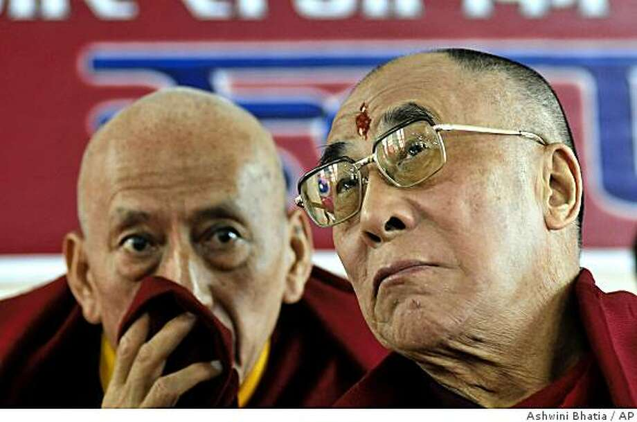 Tibetan spiritual leader the Dalai Lama, right, confers with Samdhong Rinpoche, Prime Minister of the Tibetan government-in-exile, during a function in Dharmsala, India, Thursday, Nov. 20, 2008. A summit of Tibetan exiles is turning into a clash of generations over the direction of their struggle with China. (AP Photo/Ashwini Bhatia) Photo: Ashwini Bhatia, AP