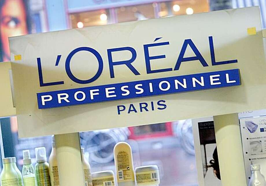 A display of l'Oreal products is seen at a hairdressing salon in Paris, Wednesday, Feb. 14, 2007. L'Oreal SA, the world's largest cosmetics maker, said profit rose 12 percent in 2006 as the company sold more Lancome luxury makeup and Armani Code perfume.Photographer: Judith White/Bloomberg News Photo: Judith White, Bloomberg News