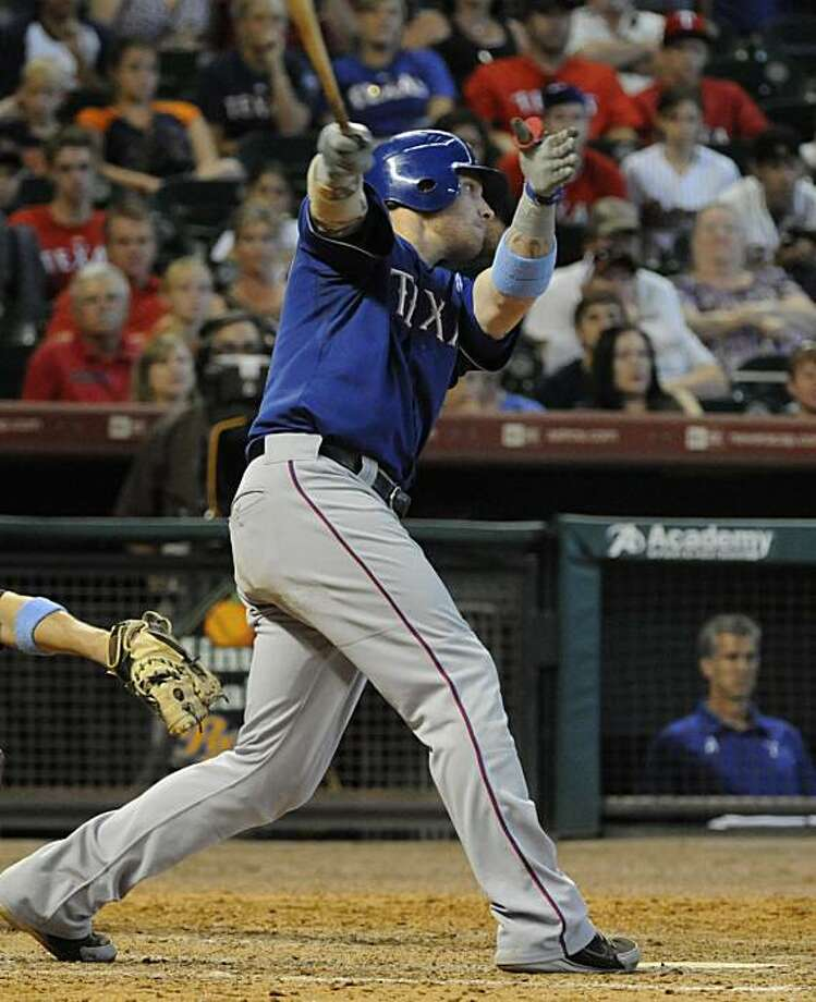 Texas Rangers' Josh Hamilton follows through on his game-winning RBI-single in the 10th inning to get ahead of the Houston Astros 5-4 in a baseball game Sunday, June 20, 2010, in Houston. Photo: Pat Sullivan, AP