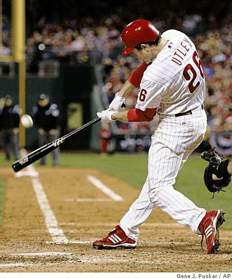 Philadelphia Phillies' Chase Utley hits a solo home run against Tampa Bay Rays' Matt Garza during the sixth inning of Game 3 of the baseball World Series in Philadelphia, Sunday, Oct. 26, 2008. (AP Photo/Gene J. Puskar) Photo: Gene J. Puskar, AP