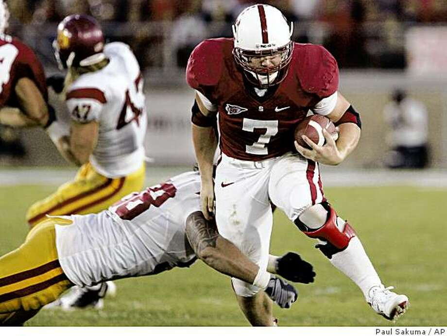 Stanford runningback Tony Gerhart (7) gets away from Southern California linebacker Rey Maualuga in the second quarter of an NCAA college football game in Stanford, Calif., Saturday, Nov. 15, 2008. (AP Photo/Paul Sakuma) Photo: Paul Sakuma, AP