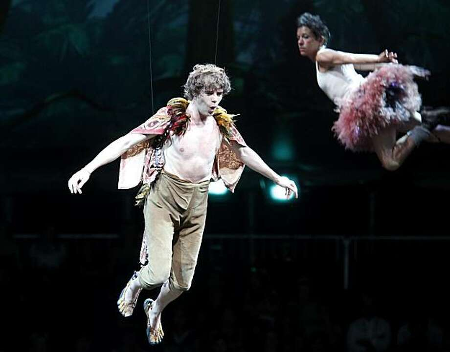 "Nate Fallows as Peter Pan prepares to land on dry land as Tinker Bell hovers nearby in ""Peter Pan."" ""Peter Pan"" with wrap-around productions inside a 360 degree tent in San Francisco, Calif. is about to make its U.S. debut. Photo: Brant Ward, The Chronicle"