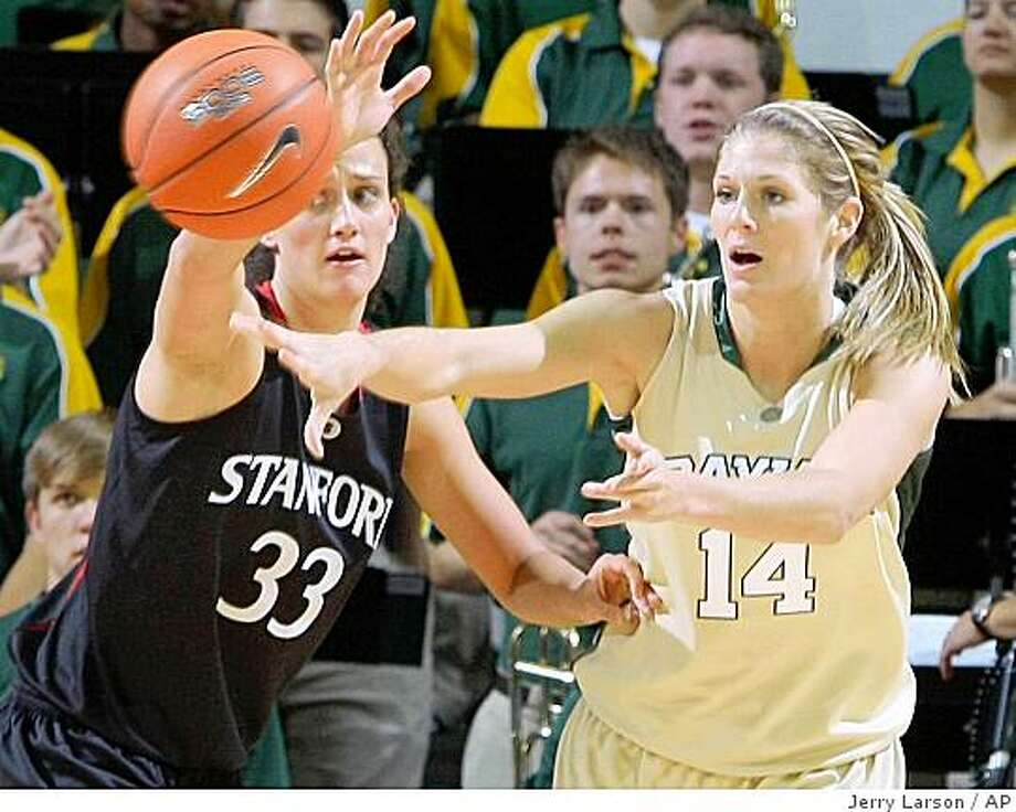 Baylor's Rachel Allison (14 ) passes the ball against Stanford's Jillian Harmon Sunday, Nov. 16, 2008, in Waco, Texas. Photo: Jerry Larson, AP