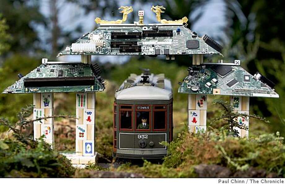 A street car pulls up to the Chinatown gate, made from circuit boards and mah jongg tiles, at the Golden Gate Express garden train exhibit at the Conservatory of Flowers in San Francisco, Calif., on Tuesday, Nov. 18, 2008. Photo: Paul Chinn, The Chronicle