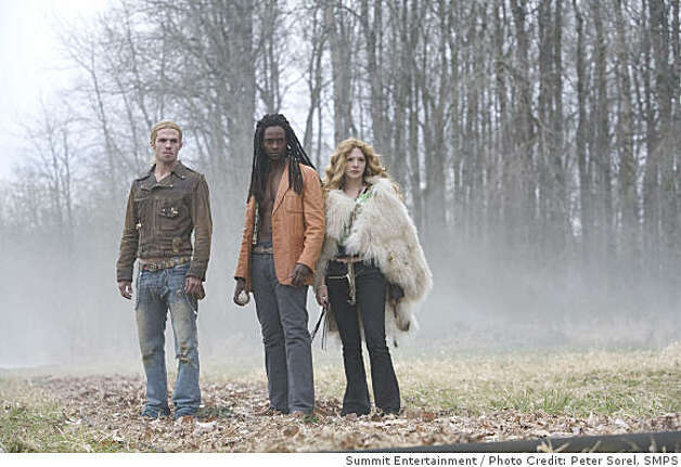 """Twilight"": Nomads: James (CAM GIGANDET), Laurent (EDI GATHEGI) & Victoria (RACHELLE LEFEVRE) emerge from the woods to play ball. Photo: Peter Sorel, Summit Entertainment"