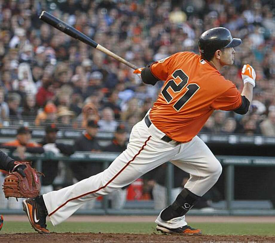 San Francisco Giants' Freddy Sanchez swings watches his RBI-single off Baltimore Orioles' Chris Tillman during the second inning of a baseball game Monday, June 14, 2010, in San Francisco. Photo: Ben Margot, AP